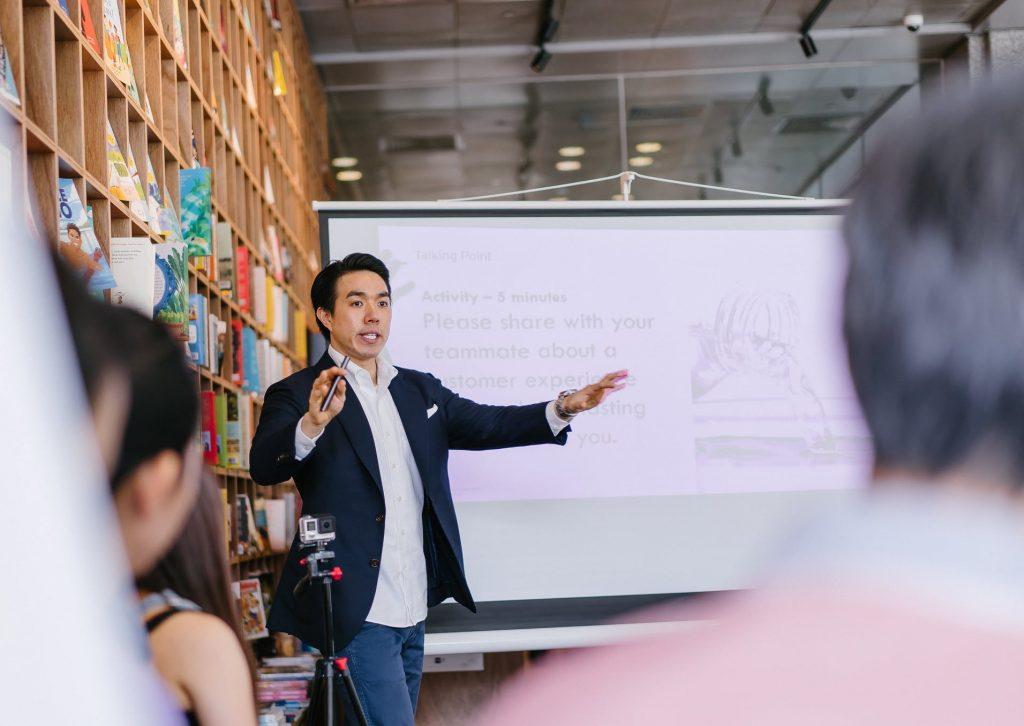 A facilitator delivering a presentation.