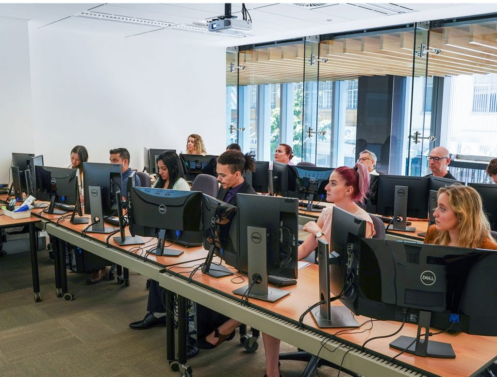 People engaged in IT training at ATI-Mirage facilities.