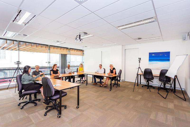 ATI-Mirage team members in a large ATI-Mirage conference room.