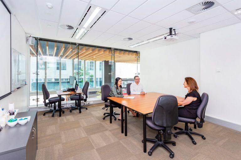 ATI-Mirage team members in a small ATI-Mirage conference room.